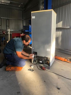 An AAKing Refrigeration mechanic testing that fridge repairs conducted have been effective